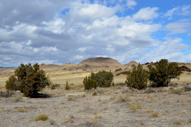 This round-topped hill overlooks the archeological site in the Cedar Mountains. A Native American Heritage tour held Nov. 6, gave more than 40 people a chance to look at stone tools and shaped arrow points and other artifacts that provide precious clues into Dugway's past according to Rachel Quist, the cultural manager for the Environmental Programs office, who hosted the tour. Photo by Bonnie A. Robinson, Dugway Proving Ground Public Affairs