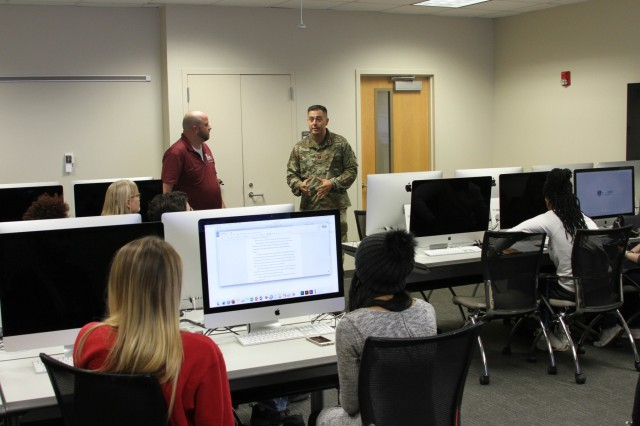 AUGUSTA, GA - Army Capt. Chad Cooper, 35th Theater Tactical Signal Brigade, public affairs officer, speaks with communication and journalism majors of Augusta University Nov. 21, at the universities Allgood Hall located in Augusta, Ga. (U.S. Army photo by Sgt. Victor Everhart Jr.)
