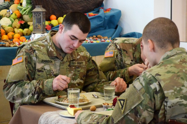 U.S. Army Pvt. Austin Johnson with the 1st Battalion, 4th Infantry Regiment, enjoys his first Thanksgiving meal away from home as a Soldier at the Joint Multinational Readiness Center's Warrior Sport Cafe Dining Facility in Hohenfels, Germany, Nov. 22, 2017. (U.S. Army photo by Staff Sgt. David Overson)