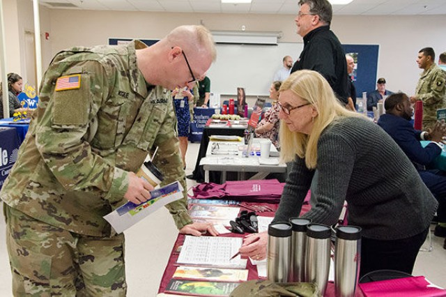 Sergeant Timothy McGee, Headquarters and Headquarters Company, 101st Airborne Division, speaks with Ellen Coleman, associate director of military and veteran education for Thomas Edison State University, Wednesday morning about the degrees offered at the university. There were 25 universities, colleges and trade schools at the Fort Campbell Education Center Education and Veterans Resource Fair at the Staff Sgt. Glenn H. English Jr. Army Education Center.