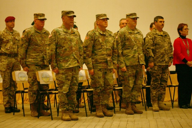 YAVORIV, UKRAINE -  U.S. Army and Canadian soldiers assigned to the Joint Multinational Training Group - Ukraine attend a JMTG-U Transfer of Authority ceremony here Nov. 22. During the ceremony Soldiers from the New York Army National Guard's 27th Infantry Brigade Combat Team (IBCT) took command of the JMTG-U from the Oklahoma National Guard's 45th IBCT, who have been in Ukraine since January.