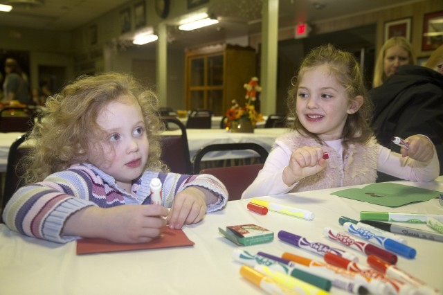 Sadie Mai, 3, left, and her sister Savannah Mai, 4, daughters of a 1st Theater Sustainment Command Soldier, make cards Nov. 15 during a 1st TSC Family Readiness Group meeting at Veterans of Foreign Wars Post 10281 in Vine Grove, Kentucky. The cards will be included in care packages that will be sent to First Team members who are deployed to Southwest Asia.