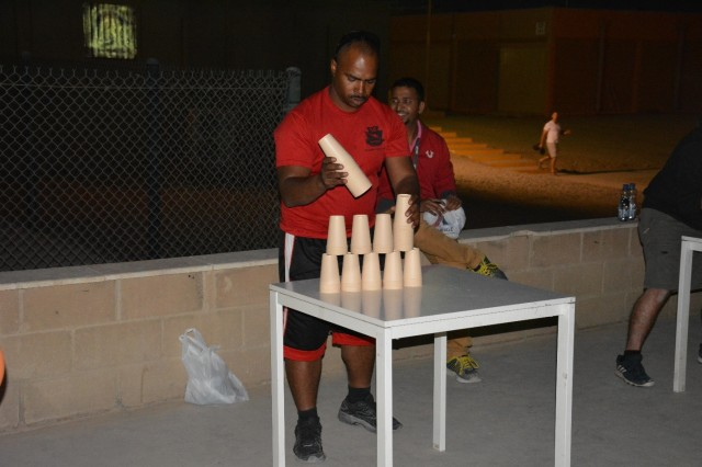 171123-A-DQ480-005 CAMP ARIFJAN, Kuwait- Private Angel Escobar, 854th Engineer Battalion, Fort Dix New Jersey competes in the MWR Turkey Games on Thanksgiving Day, Camp Arifjan, Kuwait, Nov. 23, 2017. (U.S. Army photo by 1st Lt. Vanessa Rios)