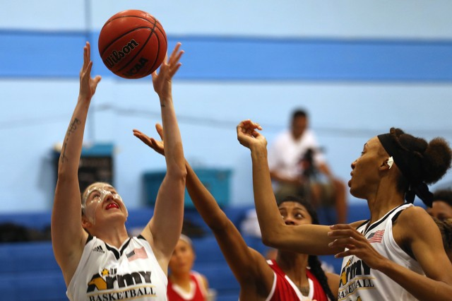 SAN ANTONIO -- Presidio of Monterey's 1st Lt. Michelle Ambuul (left) grabs one of her 10 rebounds against the Marines during Army's 95-37 win Nov. 4 in the Armed Forces Basketball tournament.