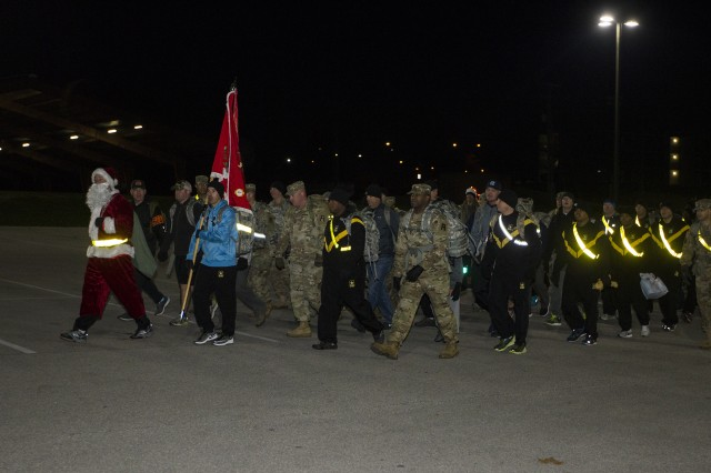 4th Cavalry Multi-Functional Training Brigade Soldiers conduct a toy drive fun foot march to the Red Cross Santa Workshop warehouse on Fort Knox, Ky. on Nov. 22, 2017. The Soldiers donated children's gifts to support the Santa's Workshop program, which provides parents an opportunity to shop for Christmas at no cost.