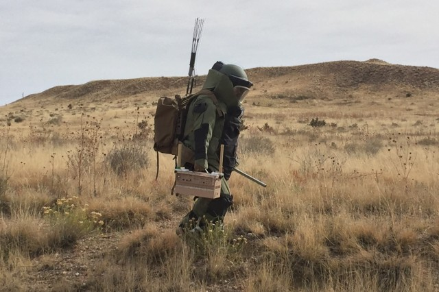 Spc. Henry Moniz, an EOD technician with 774th Ordnance Company, 242th OD BN, 71st OD GP, transport ECM equipment to the site of a simulated explosive device during a multi-day training exercise to be certified operators of the unit's electronic countermeasure equipment, Oct. 30-Nov. 2, 2017, at Fort Carson, Colo. (U.S. Army photo by 71st Ordnance Group - EOD)