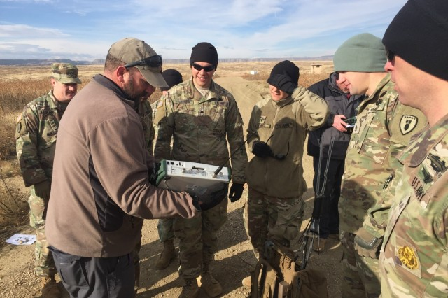 Scott Swanson, a spectrum analyzer with Fort Carson Counter IED Academy, demonstrates the frequencies radiated from ECM devices during a multi-day training exercise to be certified operators of the unit's electronic countermeasure equipment, Oct. 30-Nov. 2, 2017, at Fort Carson, Colo. (U.S. Army photo by 71st Ordnance Group - EOD)