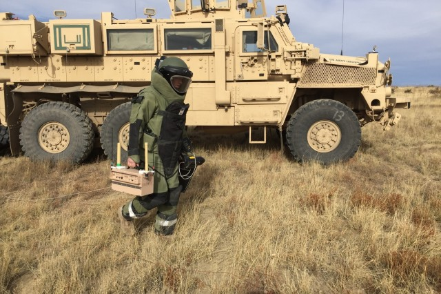 Cpl. Alexander LeBlanc, an EOD technician with 774th Ordnance Company, 242th OD BN, 71st OD GP, transport ECM equipment to the site of a simulated explosive device during a multi-day training exercise to be certified operators of the unit's electronic countermeasure equipment, Oct. 30-Nov. 2, 2017, at Fort Carson, Colo. (U.S. Army photo by 71st Ordnance Group - EOD)
