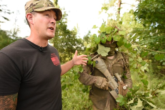 Sniper instructor Staff Sgt. Brian Moran explains the importance of proper camouflage techniques at the U.S. Army Sniper School at Fort Benning, Georgia.
