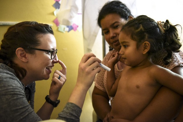 U.S. Army Capt. Theresa Urbina, Walter Reed National Military Medical Center, conducts a medical consultation with a patient during a pediatric nutritional assessment mission in Tepanguare village. JTF-Bravo MEDEL personnel participated in a pediatric nutritional assessment mission as members of a joint team with Walter Reed National Military Medical Center and the Honduran Ministry of Health to assess the nutritional status of children from the ages of 6 months to 60 months at the Matazano, Humuya, and Tepanguare villages in the Department of La Paz, Honduras from Nov. 6-9, 2017.
