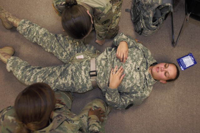 Spc. Alyssa Hobbs, combat medic, Inpatient Surgical Unit, William Beaumont Army Medical Center, is treated for a mock inguinal wound during Tactical Combat Casualty Care training at the Medical Simulation Training Center at Fort Bliss, Nov. 16.