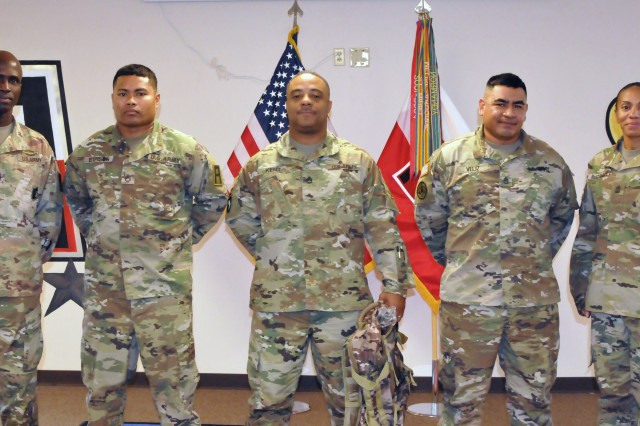 Command Sgt. Maj. John Lambert Jr. (left), First Army Academy senior enlisted advisor, and 1st Sgt. Stephanie Mcadoo-Duff (right), FAA first sergeant, pose for a picture with the Academy's Observer Coach/Trainer Instructor of the Year finalists during an award presentation at Camp Shelby, Miss., Nov. 29, 2017. Sgt. 1st Class Lester Kent (center) was recognized as the 2017 FAA OC/T Instructor of the Year.