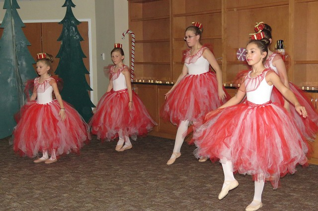 "The Candy Cane Court (left to right) Hayli Hatch, Elizabeth Hatch, Katrina Wolterstors, Rayli Hatch, and Laila Johnson, dance in a special performance of ""The Nutcracker"" presented at Madigan Army Medical Center's Joint Base Lewis-McChord Children's Autism Resource & Education Services by SKIES Unlimited on Nov. 17, JBLM, Wash. [U.S. Army Photo by Kirstin Grace-Simons/Released]"