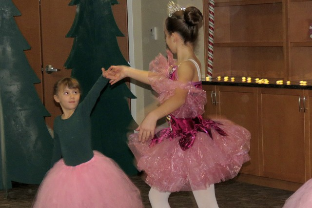 "Adelle Gillette, left, dances with Dori Emmons, aka the Dew Drop Fairy, in a special performance of ""The Nutcracker"" presented at Madigan Army Medical Center's Joint Base Lewis-McChord Children's Autism Resource & Education Services by SKIES Unlimited on Nov. 17, JBLM, Wash. [U.S. Army Photo by Kirstin Grace-Simons/Released]"