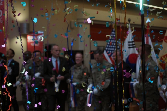 Streamers and confetti rained down when a host of dignitaries and community members cut the ribbon to open the new Camp Humphreys, Korea Main Exchange Shopping Center. The new center features more than 300,000 square feet of retail space.