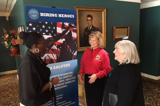 Karen Hannah talks with Roberta Berry and Nancy Adams of Warrior Care and Transition about the plethora of wounded warriors at this year's Hiring Heroes event at Joint Base Myer-Henderson Hall.