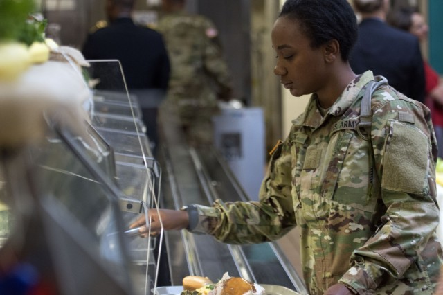 A Solder selects her Thanksgiving meal during the Nov. 22 holiday celebration at the 369th Adjutant General Battalion dining facility.