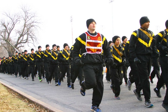 Advanced individual training Soldiers and their platoon sergeants from the 428th Field Artillery Brigade begin the seventh edition of the Run for the Fallen Nov. 22, 2017, on Quinette Road at Fort Sill, Okla. Despite freezing temperatures, about 1,600 service members and family members participated in the 5K run, which also honored Gold Star families -- those who have lost a service member on active duty.