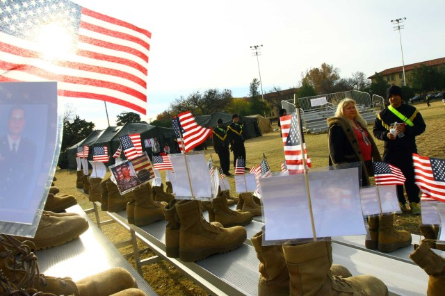 A memorial of pairs of boots,  photos and U.S. flags representing fallen service members from Oklahoma and Arkansas, was on display, Nov. 22, 2017, at the Run for the Fallen at Fort Sill, Okla.
