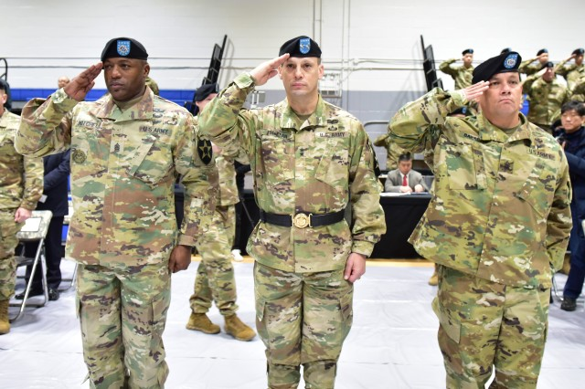 Command Sgt. Maj. Edward Mitchell (left), Maj. Gen. Scott McKean, (middle), and Command Sgt. Maj. Phil Barretto (right), salute the U.S. Flag during the National Anthem during the 2nd Infantry Division/ROK-US Combined Division Change of Responsibility Ceremony at Camp Casey, Republic of Korea Dec. 1. Mitchell leaves the division to join the U.S. Center of Initial Military Training team at Fort Eustis, Virginia, and Barretto joins the Warrior Division after serving as the Commandant, Noncommissioned Officer Academy at Fort Drum, New York. (U.S. Army Photo by Mr. Pak Chin U, 2ID/RUCD Public Affairs)