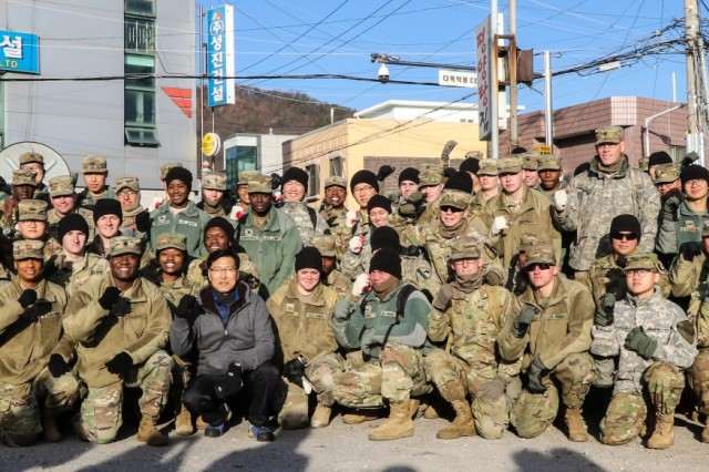 Soldiers with 210th Field Artillery Brigade, 2nd Infantry Division/ROK-US Combined Division, 2nd Armored Brigade Combat Team, 2ID/ROK-US CD pose for a group photo with Gyeonggi Province personnel and volunteers from Dongducheon community, at Dongducheon, South Korea, Nov. 30, 2017. Nearly 70 Soldiers from both brigades assisted in delivering charcoal briquettes to less fortunate families in Dongducheon. (U.S. Army photo by Sgt. Michelle U. Blesam, 210th FA Bde PAO)