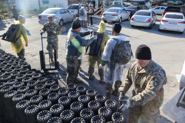 Soldiers with 210th Field Artillery Brigade, 2nd Infantry Division/ROK-US Combined Division, deliver charcoal briquettes to less fortunate families in Dongducheon, South Korea, Nov. 30, 2017. Nearly 70 Soldiers from both 210th FA BDE and 2nd Armored Brigade Combat Team, 2ID/ROK-US CD, assisted in delivering 5,000 charcoal briquettes to less fortunate families in Dongducheon community. (U.S. Army photo by Sgt. Michelle U. Blesam, 210th FA Bde PAO)