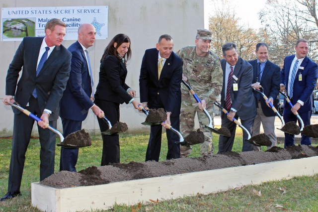Col. Ed Chamberlayne, U.S. Army Corps of Engineers, Baltimore District commander, at center, participates in a groundbreaking ceremony for the U.S. Secret Service's Maloney Canine Training Replacement Facility at the James J. Rowley Training Center in Beltsville, Maryland, Nov. 29, 2017. Chamberlayne was joined by distinguished guests from the Department of Homeland Security, U.S. Secret Service and Harkins Builders Inc. Baltimore District engineers designed and are overseeing the construction of the complex, which is estimated for completion in early 2019. (U.S. Army photo by Sarah Gross)