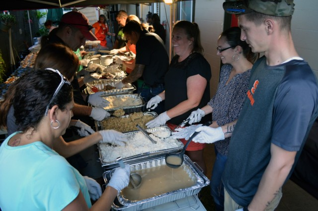 "Spouses of the 3rd Brigade Combat Team, ""Broncos,"" 25th Infantry Division, prepare plates of food for the 6th Annual Surfing the Nations Thanksgiving at Wahiawa, Hawaii, on Nov. 22, 2107. More than 40 members of the Bronco family supported hundreds in the local Wahiawa community this Thanksgiving. (U.S. Army photo by Staff Sgt. Armando R. Limon, 3rd Brigade Combat Team, 25th Infantry Division)"