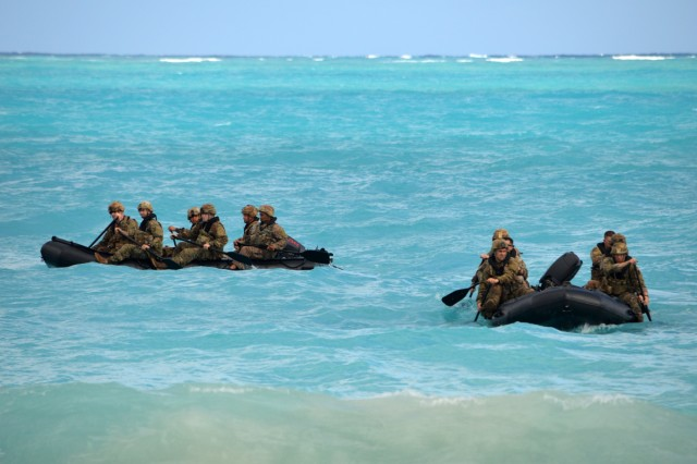 Soldiers assigned to the 3rd Squadron, 4th Cavalry Regiment, 3rd Brigade Combat Team, 25th Infantry Division, approach a beach with their F470 Zodiacs [combat rubber raiding craft] off the coast of Marine Corps Training Area Bellows, Hawaii, on Nov. 29, 2017. The Soldiers participated in waterborne training with his unit in the Pacific Ocean. (U.S. Army photo by Staff Sgt. Armando R. Limon, 3rd Brigade Combat Team, 25th Infantry Division)