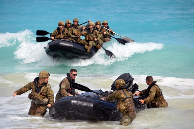 Soldiers assigned to the 3rd Squadron, 4th Cavalry Regiment, 3rd Brigade Combat Team, 25th Infantry Division, make a successful beach landing with their F470 Zodiacs [combat rubber raiding craft] off the coast of Marine Corps Training Area Bellows, Hawaii, on Nov. 29, 2017. The Soldiers participated in waterborne training with his unit in the Pacific Ocean. (U.S. Army photo by Staff Sgt. Armando R. Limon, 3rd Brigade Combat Team, 25th Infantry Division)