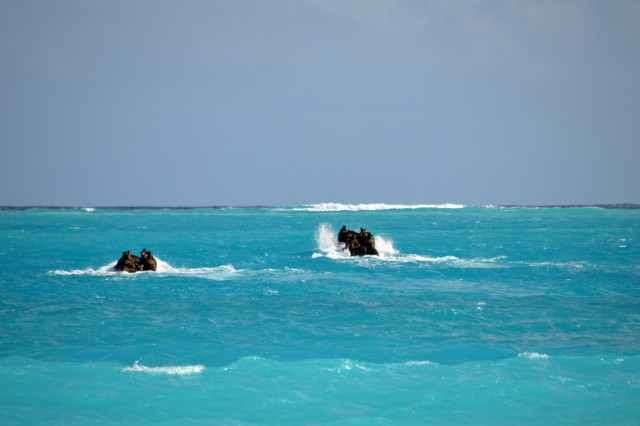 Soldiers assigned to the 3rd Squadron, 4th Cavalry Regiment, 3rd Brigade Combat Team, 25th Infantry Division, ride aboard F470 Zodiacs [combat rubber raiding craft] of the coast of Marine Corps Training Area Bellows, Hawaii, on Nov. 29, 2017. The Soldiers participated in waterborne training with his unit in the Pacific Ocean. (U.S. Army photo by Staff Sgt. Armando R. Limon, 3rd Brigade Combat Team, 25th Infantry Division)