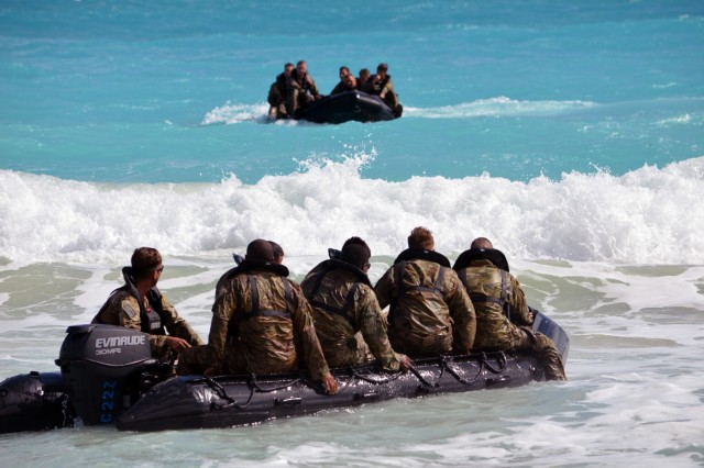 Soldiers assigned to the 3rd Squadron, 4th Cavalry Regiment, 3rd Brigade Combat Team, 25th Infantry Division, ride aboard F470 Zodiacs [combat rubber raiding craft] at Marine Corps Training Area Bellows, Hawaii, on Nov. 29, 2017. The Soldiers participated in waterborne training with his unit in the Pacific Ocean. (U.S. Army photo by Staff Sgt. Armando R. Limon, 3rd Brigade Combat Team, 25th Infantry Division)
