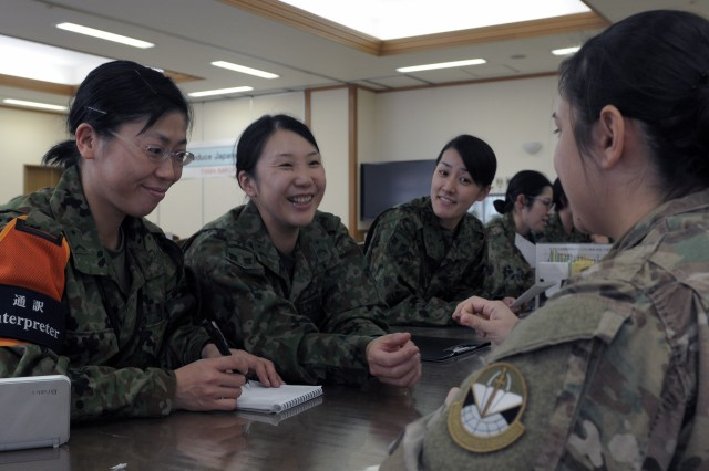 U.S. and Japanese Ground Self Defense Force NCOs with the Northeastern Army meet to discuss roles and responsibilities of the Noncommissioned Officer prior to kicking off exercise Yama Sakura 73 at Camp Sendai, Japan.