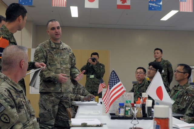 Sgt. Maj. Jared Dowland, 593rd Expeditionary Sustainment Command, Chief Communications Noncommissioned Officer, speaks with fellow U.S. and Japanese NCOs about a variety of topics related to Soldier development and morale as well as the roles of the Noncommissioned Officer and the differences in responsibilities between the two Armies.