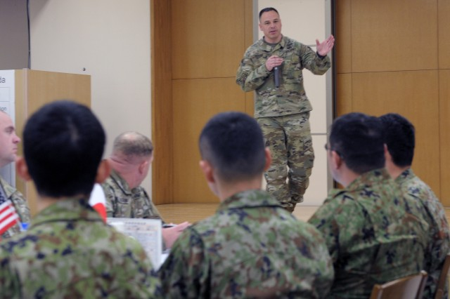 Command Sgt. Maj. James D. House, Headquarters and Headquarters Battalion, I Corps, Command Sergeant Major addresses NCOs from the Japanese Ground Self Defense Force, I Corps, and U.S. Army Japan prior to an NCO collaboration forum at Camp Sendai, Japan.