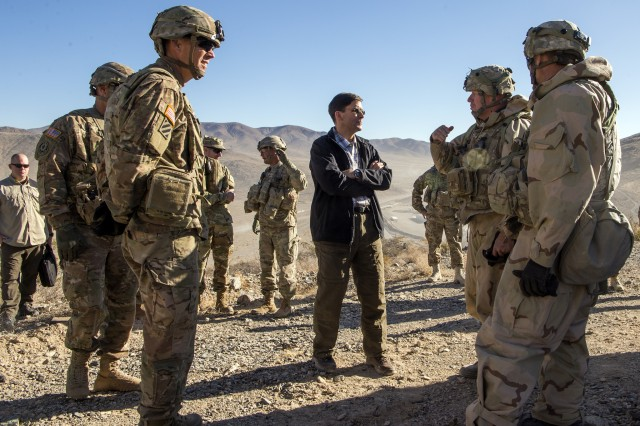 Secretary of the Army Mark T. Esper speaks with Col. Wilson R. Rutherford IV, commander, 1st Armored Brigade Combat Team, 1st Cavalry Division about the unit's experience at the National Training Center, Dec. 1.