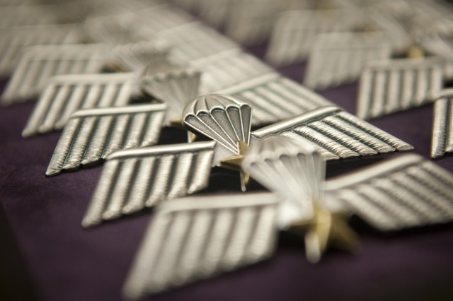The foreign jump wings carefully counted and lined up by Soldiers from the 350th Human Resources Company from Grand Prairie, Texas, during the 20th Annual Randy Oler Memorial Operation Toy Drop, hosted by U.S. Army Civil Affairs and Psychological Operations Command (Airborne), Dec. 2, 2017. Operation Toy Drop is the world's largest combined airborne operation with eight partner nation paratroopers participating and allows Soldiers the opportunity to train on their military occupational specialty, maintain their airborne readiness, and give back to the local community.