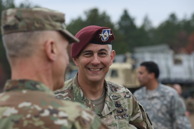 Lt. Gen. Stephen J. Townsend, commanding general of XVIII Airborne Corps, greets fellow paratroopers after jumping from a C-130 Hercules at Sicily Drop Zone for the 20th Annual Randy Oler Memorial Operation Toy Drop, hosted by U.S. Army Civil Affairs & Psychological Operations Command (Airborne), Dec. 2, 2017 at Fort Bragg, North Carolina. Operation Toy Drop is the world's largest combined airborne operation with eight partner nations paratroopers participating this year.  It gives Soldiers the opportunity and allows to train on their military occupational specialty, maintain their airborne readiness, and give back to the local community.