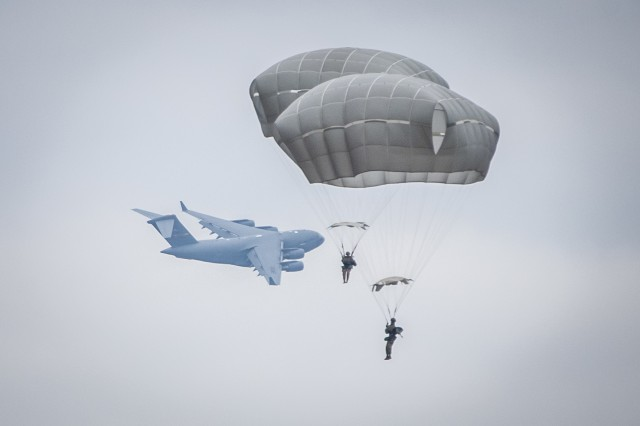 Paratroopers conduct airborne operations at Sicily Drop Zone during the 20th Annual Randy Oler Memorial Operation Toy Drop, Dec. 2, 2017. Operation Toy Drop, hosted by the U.S. Army Civil Affairs & Psychological Operations Command (Airborne) and is the largest combined airborne operation conducted worldwide. The event and allows Soldiers the opportunity to train on their military occupational specialty, maintain their airborne readiness, and give back to the local community.