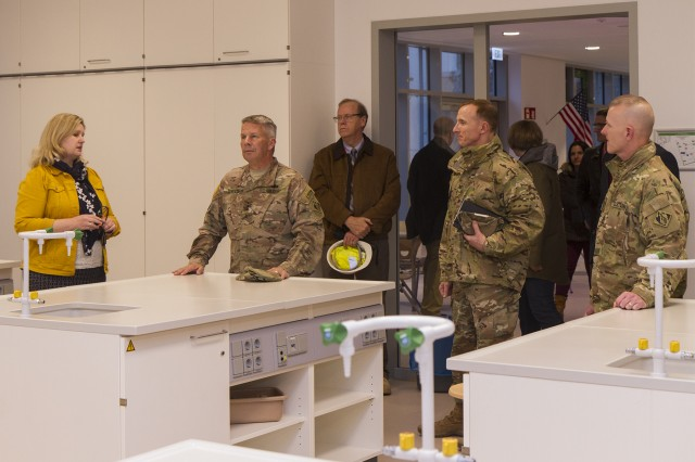 Dr. Sandra Whitaker, left, principal of Wiesbaden High School, discusses the lab classroom in Department of Defense Education Activity's first 21st-century high school with Lt. Gen. Todd Semonite, commanding general of the U.S. Army Corps of Engineers, and Command Sgt. Maj. Bradley Houston, USACE command sergeant major, during a tour of the high school Nov. 27, in Wiesbaden, Germany.