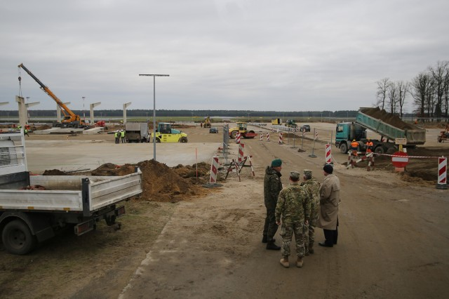 Polish Brig. Gen. Dariusz Lukowski, chief of Inspectorate for Armed Forces Support, Col. John Baker, commander of Europe District, U.S. Army Corps of Engineers, Lt. Gen. Todd Semonite, USACE commanding general, and John Adams. Europe District deputy district engineer, view construction in Powidz, Poland.
