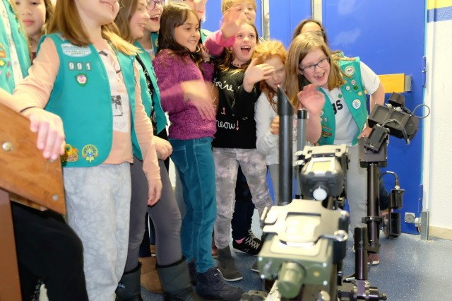 Sembach Girl Scouts Juniors Troop 991 enjoy the camera on the 773rd Civil Support Team's Talon IV surveying robot Monday, Dec. 4, 2017 at Sembach Middle School. The Juniors were earning the robotics patch, and the 773rd CST brought the robot for the meeting.