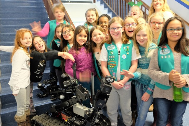 Sembach Girl Scouts Juniors Troop 991 pose with the 773rd Civil Support Team's Talon IV surveying robot Monday, Dec. 4, 2017 at Sembach Middle School. The Juniors were earning the robotics patch, and the 773rd CST brought the robot for the meeting.