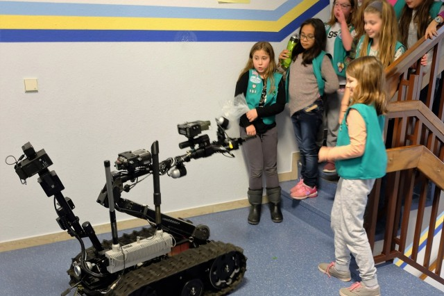 05.	Sembach Girl Scouts Juniors Troop 991 react to the 773rd Civil Support Team's Talon IV surveying robot Monday, Dec. 4, 2017 at Sembach Middle School. The Juniors were earning the robotics patch, and the 773rd CST brought the robot for the meeting.