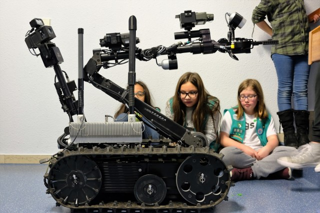 Sembach Girl Scouts Juniors Troop 991 examine the 773rd Civil Support Team's Talon IV surveying robot Monday, Dec. 4, 2017 at Sembach Middle School. The Juniors were earning the robotics patch, and the 773rd CST brought the robot for the meeting.