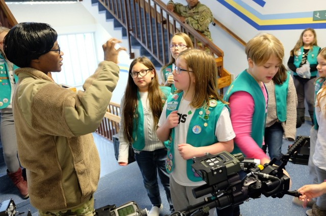 Sgt. 1st Class Yuolanda Carey, 773rd Civil Support Team survey team chief, answers questions Sembach Girl Scouts Juniors Troop 991 as her team demonstrates the Talon IV surveying robot Monday, Dec. 4, 2017 at Sembach Middle School.