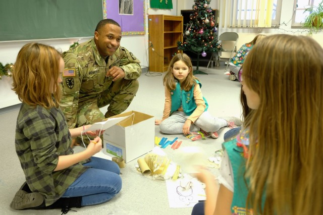 Staff Sgt. Patrick McNeely, 773rd Civil Support Team, builds a robot with girls from Sembach Girl Scouts Juniors Troop 991 Monday, Dec. 4, 2017 at Sembach Middle School.