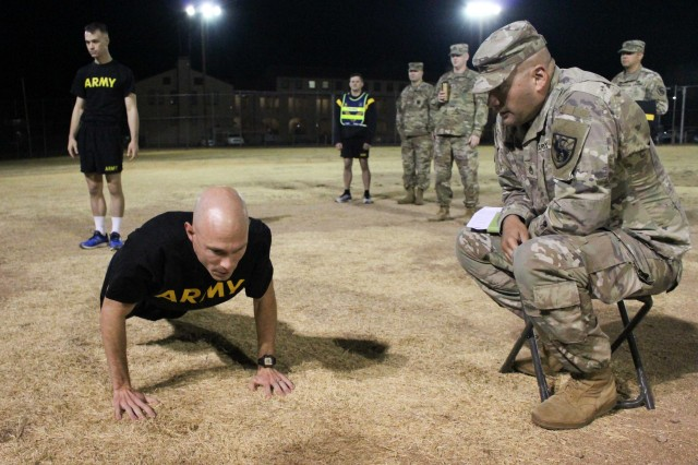 Staff Sgt. James Russell, who won Platoon Sergeant of the Quarter, from the 305th Military Intelligence Bn., executes the pushup portion of the Army Physical Fitness Test during the 111th Military Intelligence Brigade Platoon Sergeant, Noncommissioned Officer (NCO), and Soldier of the Quarter competition at Fort Huachuca 14 Nov.