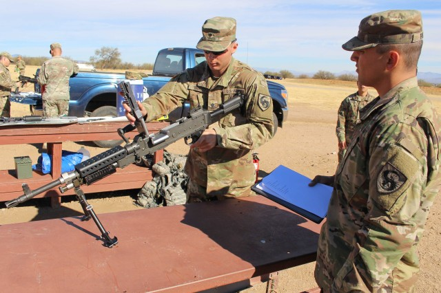 Spc. Zain Shaito, who won Soldier of the Quarter, from the Headquarters, 111th Military Intelligence Bde., displays his technical knowledge of the M-240 Machine Gun during the 111th Military Intelligence Brigade Platoon Sergeant, Noncommissioned Officer (NCO), and Soldier of the Quarter competition at Fort Huachuca 15 Nov.