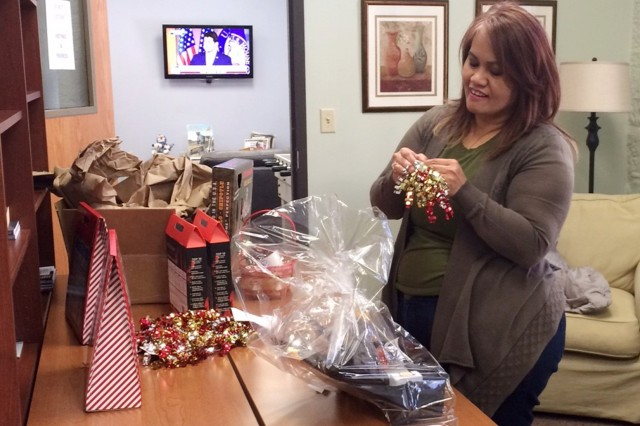 Volunteer Leah Yokas assembles a gift basket at the Rock Island USO Center, Nov. 30.
